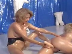 German Girls Wrestling in Oil with a Dildo 2