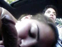 Sweet brunette blowing dick within the car