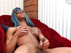 Lactating nubian sheboy jerks her bbc and cums