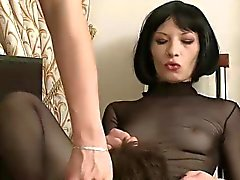 2 mistresses caning submissive guy