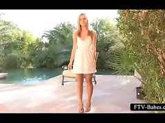 Blonde amateur sweetie rubbing her clit by the pool