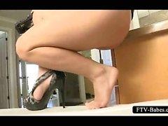 Kinky brunette sticking a shoe heel in her snatch