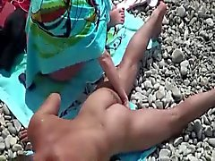 Voyeur tapes couple fucks on the beach