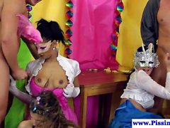 Masked pissing babes jizzed in orgy party