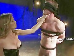Two blondes pour hot wax on three males