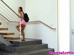 Busty babe queening cute teen in les action