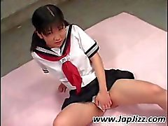 Cute little Asian schoolgirl rubs her pussy and gets vibrated