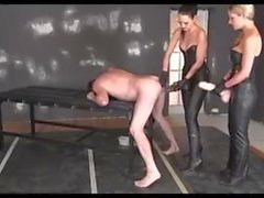 A lucky slave is fucked by two big strapons