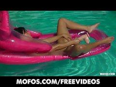 Bikini clad brunette oils up and masturbates in the pool