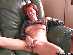 Mature redheaded mom masturbates on the couch
