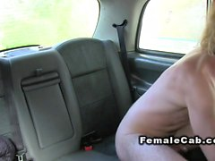 Sexy blonde female cab driver bangs in backseat