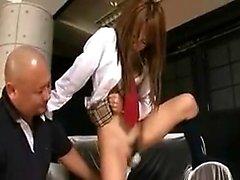 Pretty Asian schoolgirl has a vibrator working its magic on