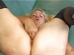 Droopy-boobed blonde gets off with hr fingers and a cell phone
