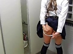 College uniform in a bathroom that is public.