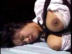 Stacked Japanese babe gets her body tied up and her pussy d