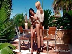 Two hot lesbians are out in the sun and get naked to kiss and fondle