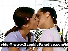 Lovely brunette lesbians kising and licking nipples and having lesbian love