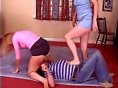 2 fem sit on 1 male