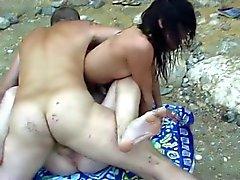 Trekant på stranden