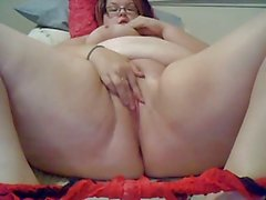 chubby girl with glass rubbing her pussy
