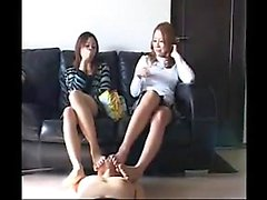 Two seductive Japanese ladies put their feet to work on a t
