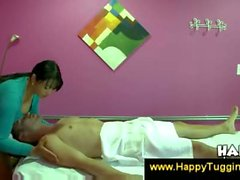 Busty asian masseuse offers a handjob