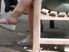 Mature Feet in Wedge Flip Flops