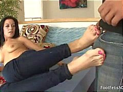 Brunette Vanessa gives a nice footjob after he kisses and licks her toes