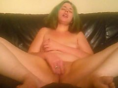 Freaky girl in a green wig rubs her nipples and fingers her