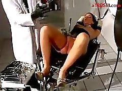 Girl In Latex Corset Dildo Pump In Ass Getting Her Pussy Stimulated With Vibrator Tortured With Clips And Speculum By Doctor On The Medical Chair