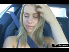 Gorgeous blonde teen rubs tits and cunt in car