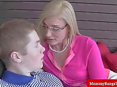 Blonde milf gets oral pleasures from a teen guy
