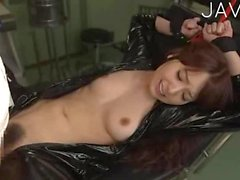 Bondaged Jap slut in latex suit