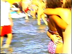 Spring-break girls have fun on beach