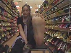 Young Latina mom shows off feet at walmart