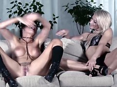 Patti and Aby take turns on a big cock