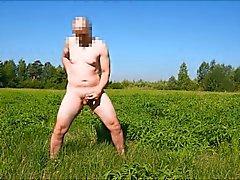 Wanking with cumshot in open public field