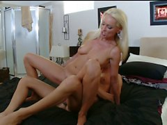 Stunning MILF seduces young guy to fuck her in bed