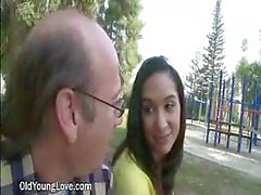 Cute Young Brunette Flirts With A Grandpa