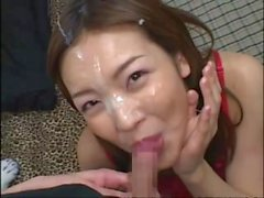 Stunning Japanese babe gets a facial cumshot after giving a perfect blowjob