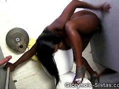 Busty black babe sucks off white dicks from glory holes