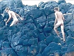 Good looking gay boys screwing on the beach