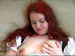 Girl in maid outfit uses toy