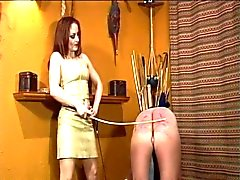 Girl gets her whip for spanking guy on stool