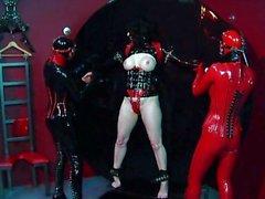 Rubber clad trio dominatrix action