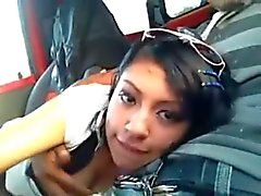 Cute Latina Sucks Off Her Boyfriend in his Car.