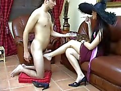 Slave jerking off her mistress foot