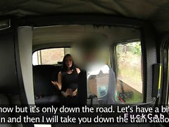Huge tittied brunette in fake taxi