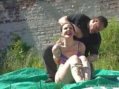 Outdoor bondage and cloth gagging of dominated submissive Ca