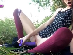 nympho teen masturbates in the grass